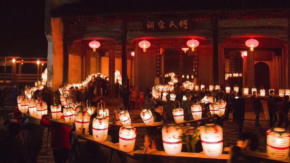 Villagers participate in the Bench Dragon Lantern Parade in east China