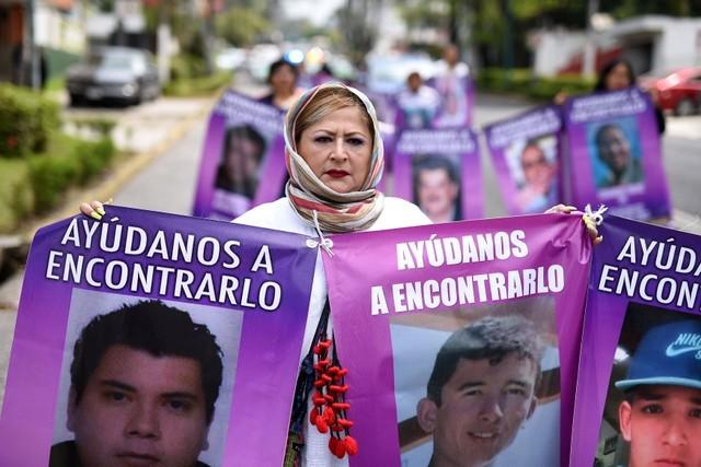 Mexican mothers mark their day pining for missing children
