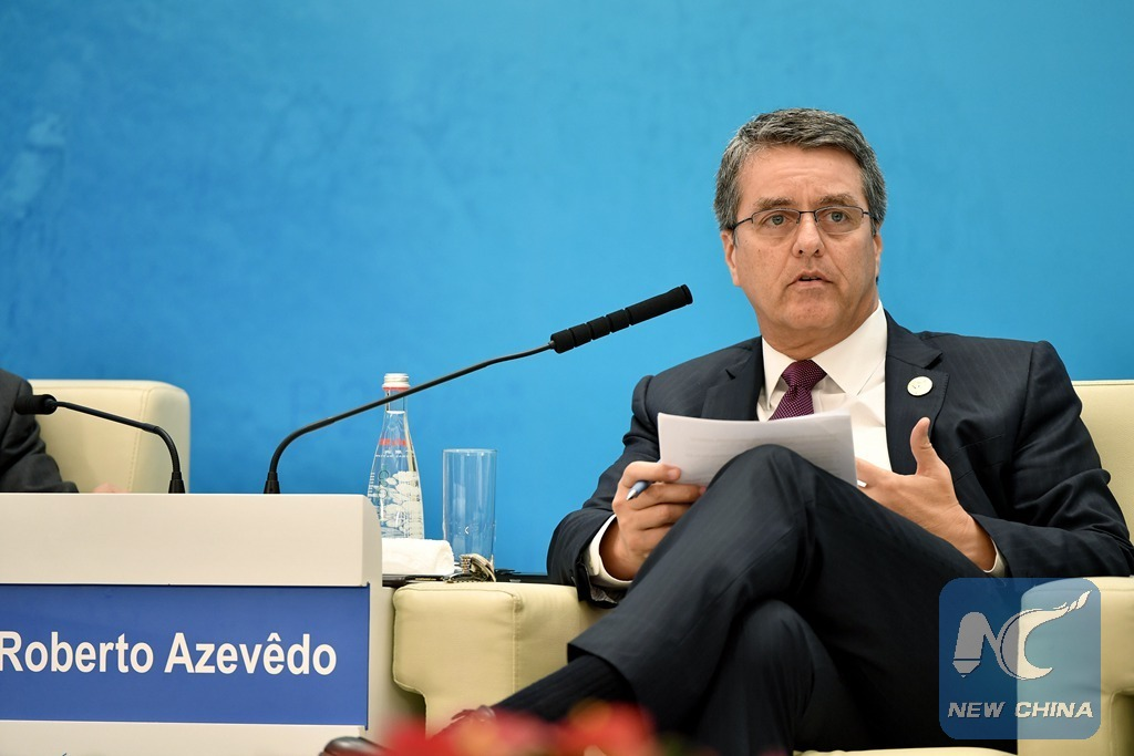 WTO chief urges members to seek solutions on systemic challenges