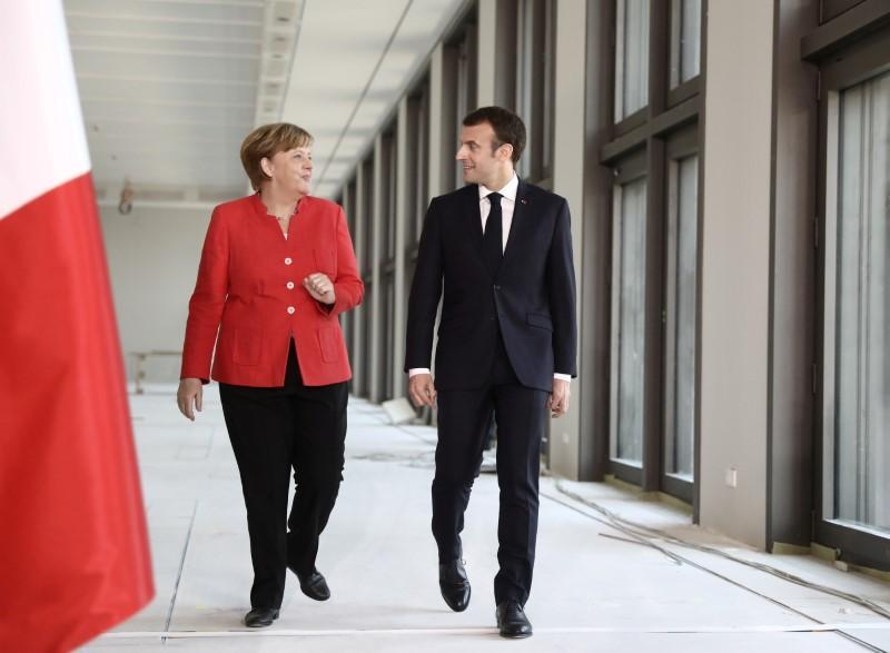 """Amid trade tensions, Merkel commends Macron's 'elan'""的图片搜索结果"