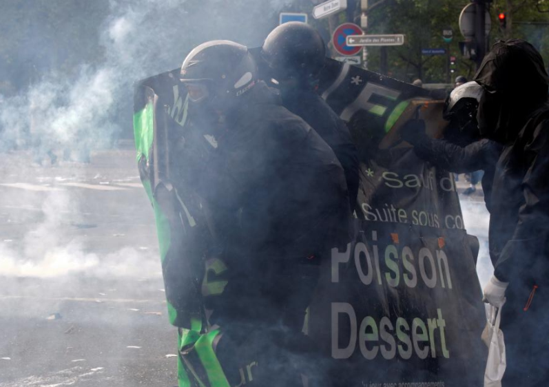 Riot police use teargas against anarchists at Paris May Day rally
