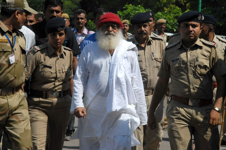 Indian court jails popular guru for life over teen rape