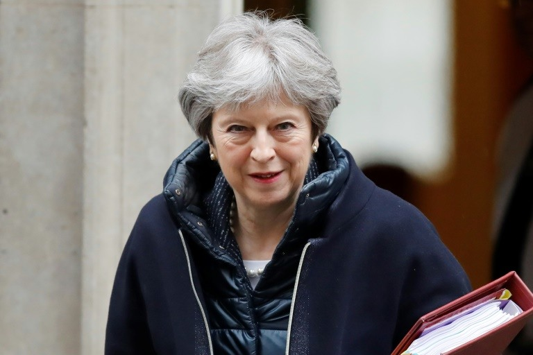 May mulls Syria action despite cautious mood in UK