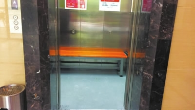 Benches installed in elevators in SW China to keep electric scooters out