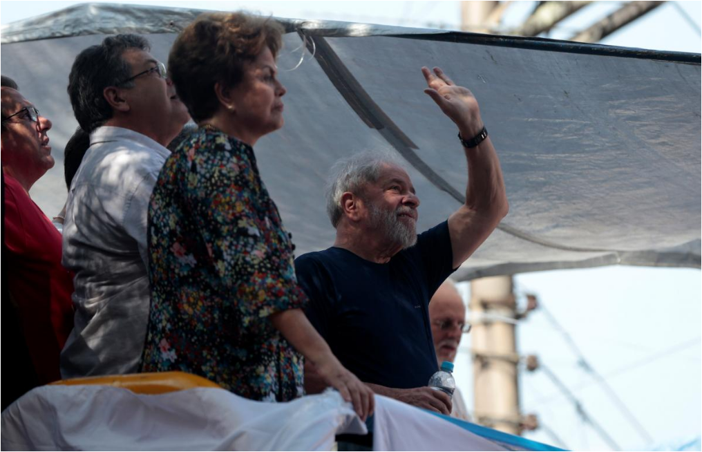 Lula agrees to surrender to Brazil police after defying order