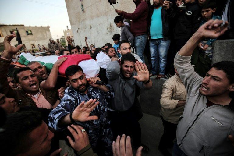 Palestinians bury their dead after Israel kills nine in border clashes