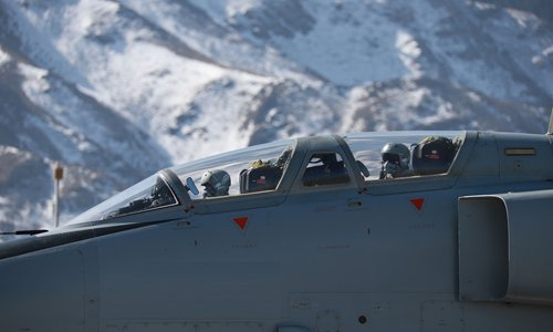 JH-7 fighter bombers fly near Tianshan Mountains - Global Times