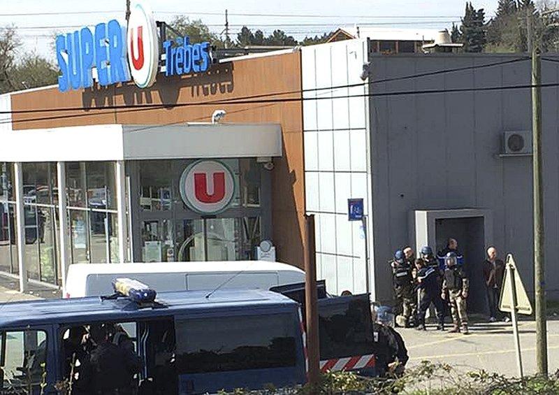 French police storm supermarket, kill hostage-taker; 3 dead