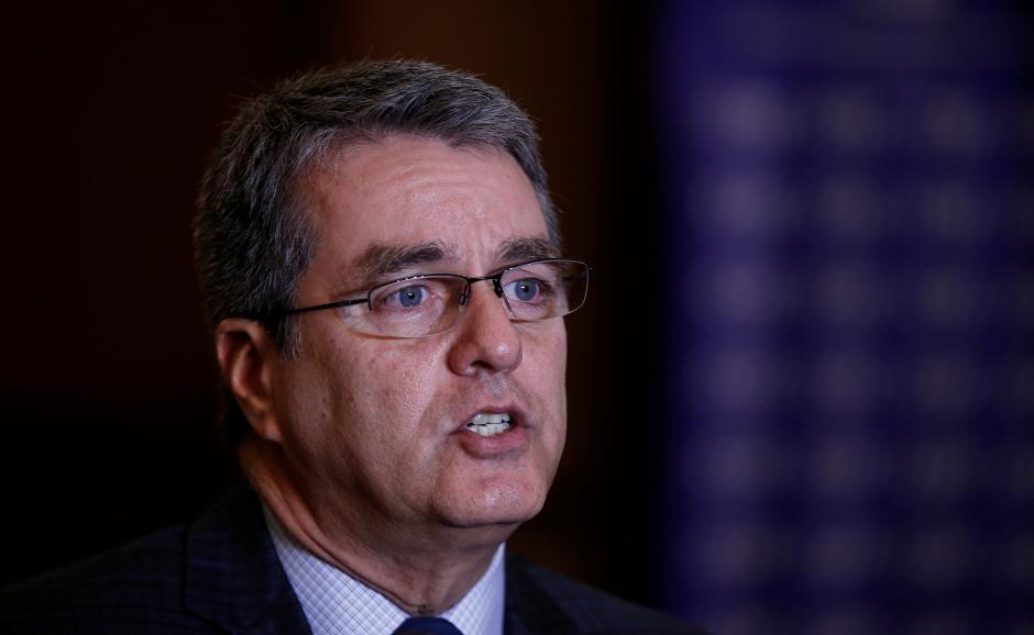 WTO chief warns of disruption to global economy, urges restraint