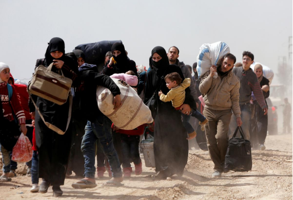 Thousands more Syrians flee their homes as two battles rage