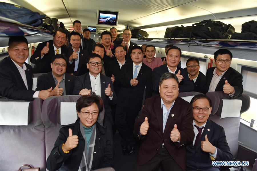 """NPC deputies, CPPCC members from HK arrive in Beijing for annual """"two sessions"""""""