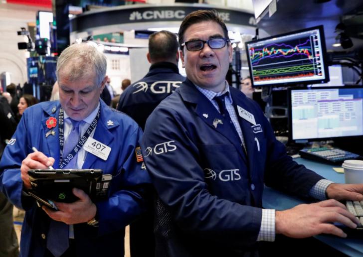 Wall Street pares gains as energy, health stocks drag