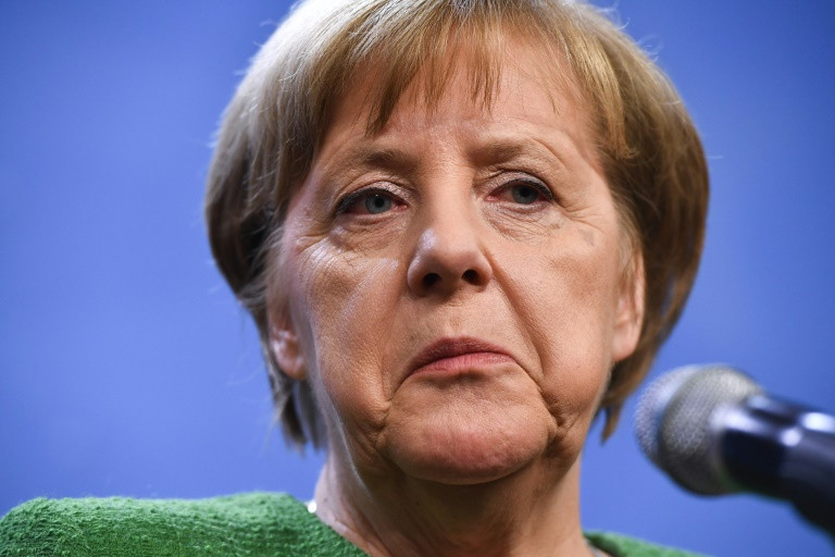 Merkel to appoint key party critic to cabinet