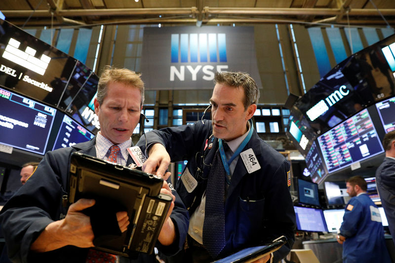 Stocks climb as Fed eases rate concern, tech rises