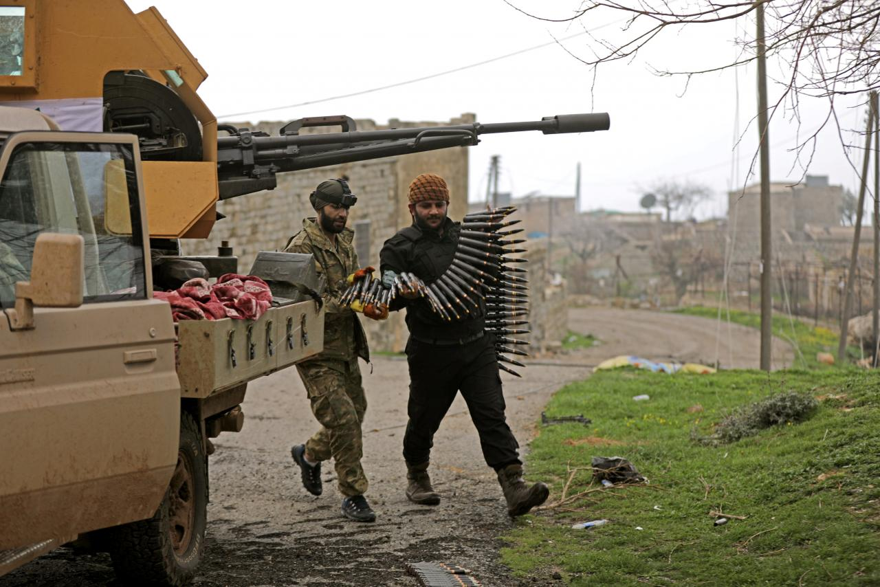 Turkish forces shell convoy headed to Syria's Afrin region