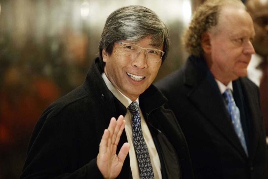 FILE - In this Jan. 10, 2017, file photo, pharmaceuticals billionaire Dr. Patrick Soon-Shiong waves as he arrives in the lobby of Trump Tower in New York for a meeting with President-elect Donald Trump. The Los Angeles Times is reporting its parent company is in talks to be sold to Soon-Shiong. The Washington Post first reported Tuesday, Feb. 6, 2018 that the sale was being negotiated by Tronc Inc., formerly Tribune Publishing. The Times then reported that the price was $500 million and would include the San Diego Union-Tribune. Chicago-based Tronc owns 10 U.S. newspapers. Photo: Evan Vucci, AP / Copyright 2017 The Associated Press. All rights reserved.