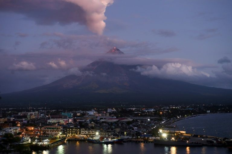 Gasps and awe as supermoon rises over erupting Philippine volcano