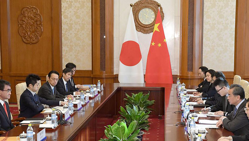 Japanese FM's China visit breaks deadlock but analysts warn of two-faced strategy