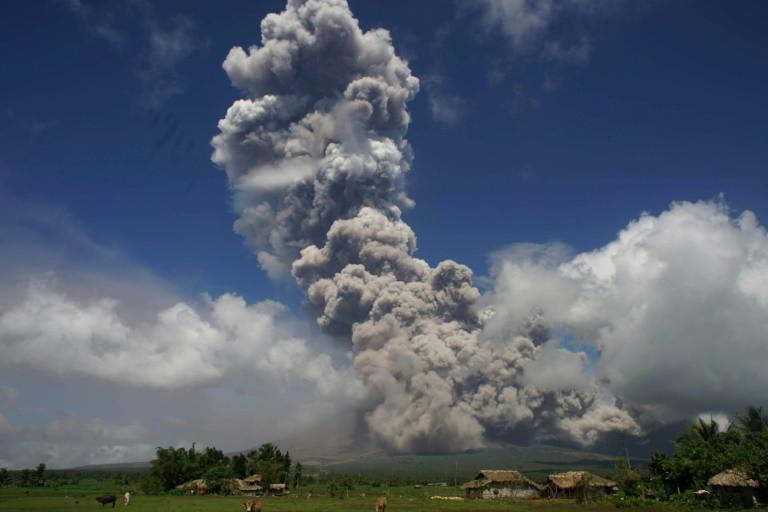 Philippine volcano rains ash, violent eruption feared