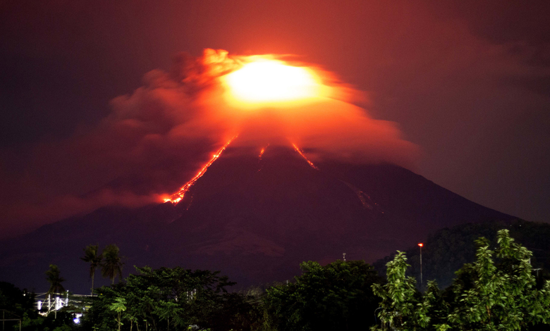 Lava cascades down the slopes of Mayon volcano as seen from Legazpi city, Albay province, around 340 kilometers (210 miles) southeast of Manila, Philippines, Monday, Jan. 15, 2018. More than 9,000 people have evacuated the area around the Philippines' most active volcano as lava flowed down its crater Monday in a gentle eruption that scientists warned could turn explosive. (AP Photo/Earl Recamunda)