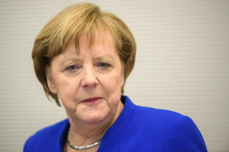 Merkel risks leading weak 'losers' coalition for Germany