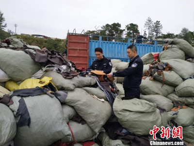 China seizes 26 tons of foreign waste smuggled from Vietnam