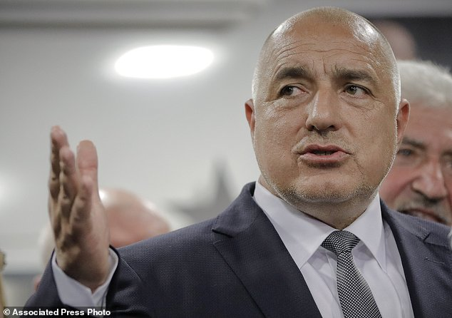 Bulgarian ex-Premier Boiko Borisov, leader of the center-right GERB party, gestures during a statement at the party's headquarters, in Sofia, Bulgaria, Sunday, March 26, 2017. Bulgaria's center-right GERB party of former Prime Minister Boiko Borisov leads by 4 percent in Sunday's parliamentary elections , according to two separate exit polls conducted by the Alpha Research and the Gallup International Bulgaria polling agencies. (AP Photo/Vadim Ghirda)