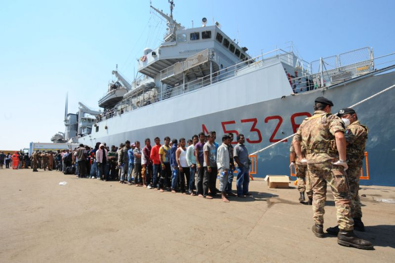 "More than 2,000 migrants disembark from Italian military ship ""Etna"" on July 19, 2014 in the port of Salerno, southern Italy, following a rescue operation (AFP Photo/Mario Laporta)"