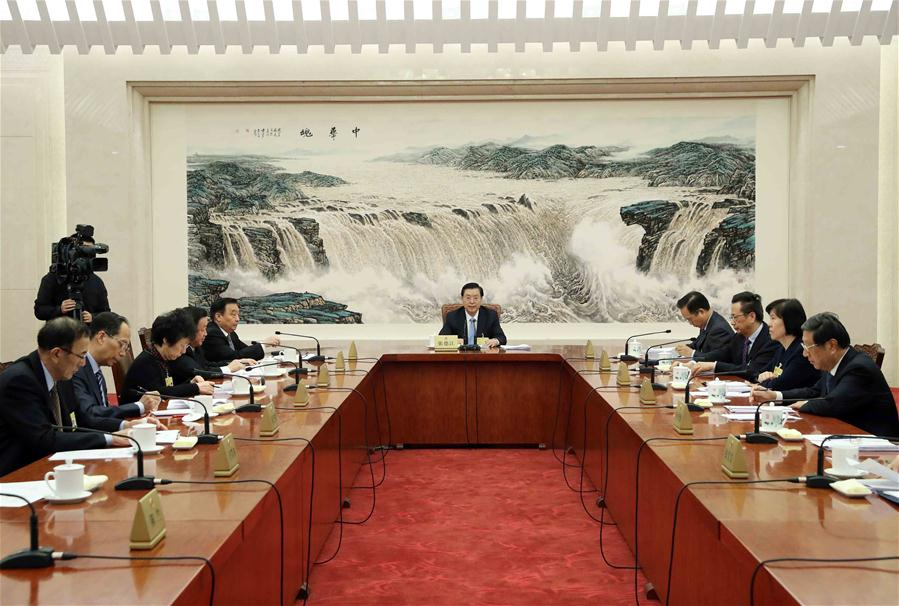 Chinese senior lawmakers review reports