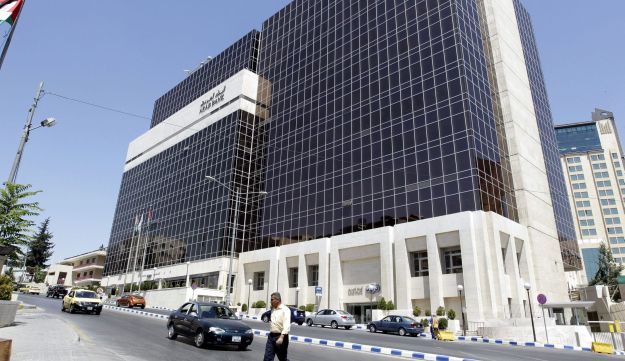 A picture taken on August 16, 2014 shows the Arab Bank's main offices in the Jordanian capital, Amman. Jordan's Arab Bank went on trial on August 15, 2014 in New York accused of aiding terror by transferring support funds to the families of Palestinians who died in the conflict with Israel. The families of several Americans killed in early 2000s attacks by the Islamic movement Hamas said the bank, which has a New York branch, was in violation of the 2001 Anti-Terrorism Act when it served as a conduit for the money from a Saudi Arabian fund to the Palestinian families.