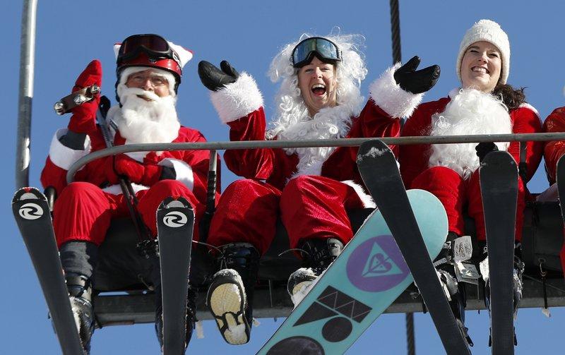 Skiing Santas ho-ho-hold court at ski resort's annual bash