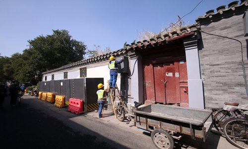 Restoring Beijing's ancient hutong means the new must go