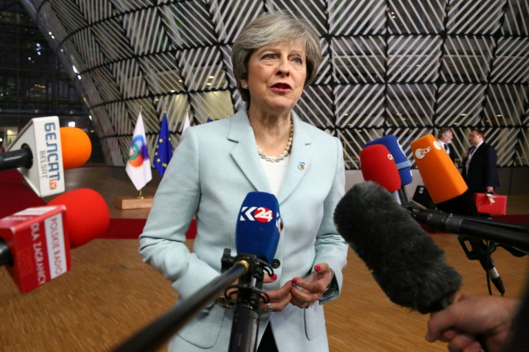 May urges EU to 'step forward' for Brexit deal