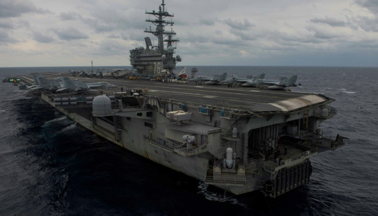 Massive search expands for US sailors after Philippine Sea air crash