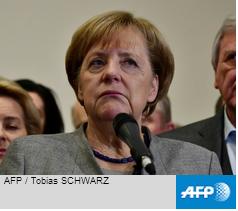 Merkel battles to stay in power despite crisis