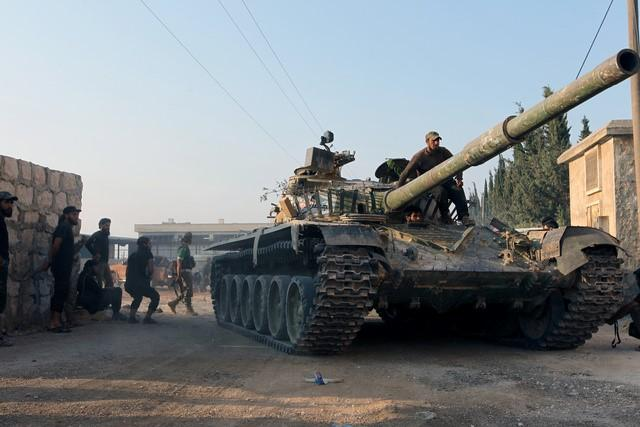 Russia, Syria armies step up attacks on Damascus enclave-rebels