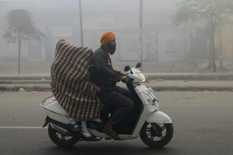 'Don't panic' says Indian minister as smog crisis deepens