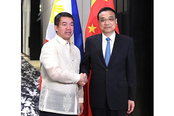 China, Philippines sign 14 deals, vow to boost ties