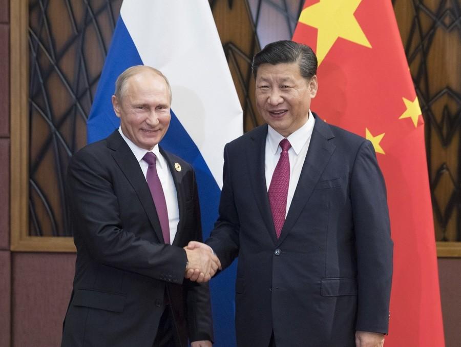 Xi, Putin pledge to enhance regional, int'l cooperation