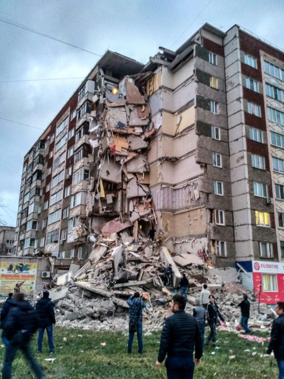 At least two dead as nine-story building collapses in Russia
