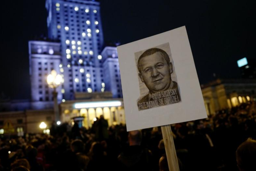 March in Poland mourns man who set himself on fire in anti-government protest