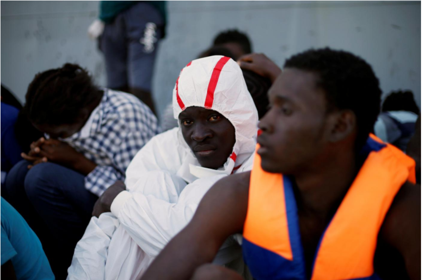 Five migrants die when boat sinks, Libyan coast guard and German NGO blame each other
