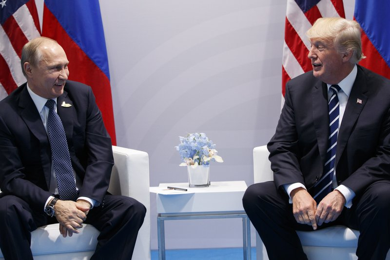 Image result for US President Donald Trump shakes hands with Russian President Vladimir Putin during their bilateral meeting at the G20 summit in Hamburg in July 2017.