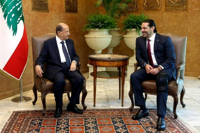 Lebanese president won't accept PM's resignation until he returns