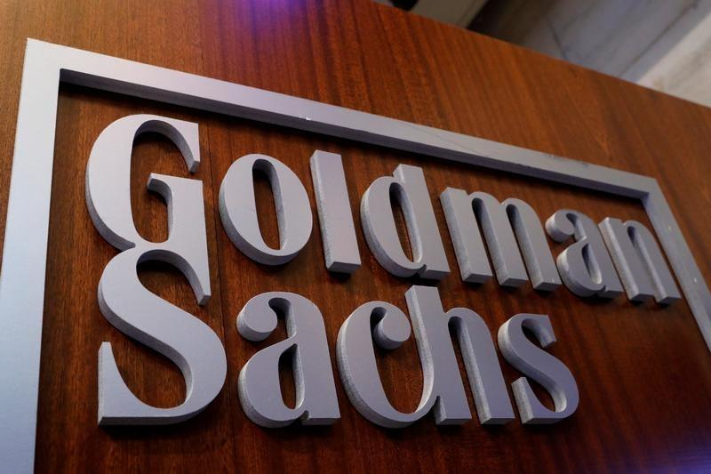Goldman jokes, takes 'bites' out of pizza to attract borrowers