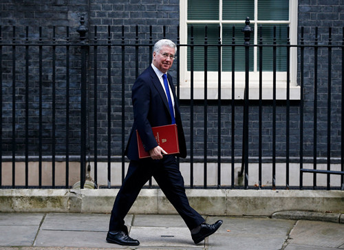 UK's May replaces defense chief as harassment scandal widens