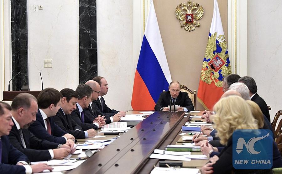 Putin pledges measures to slash Russia's regional commercial debts