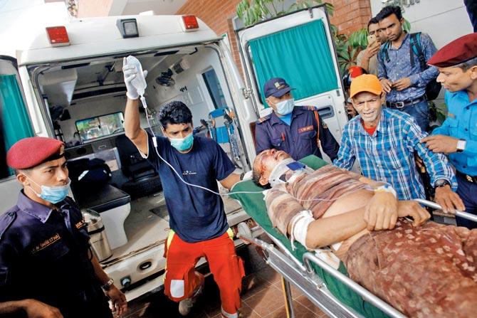 Bus veers off highway in Nepal, killing 14 people