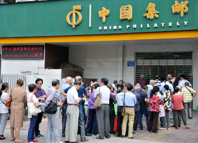 Chinese residents line up to purchase the commemorative stampfor the 19thNational Congress for the Communist Party of China