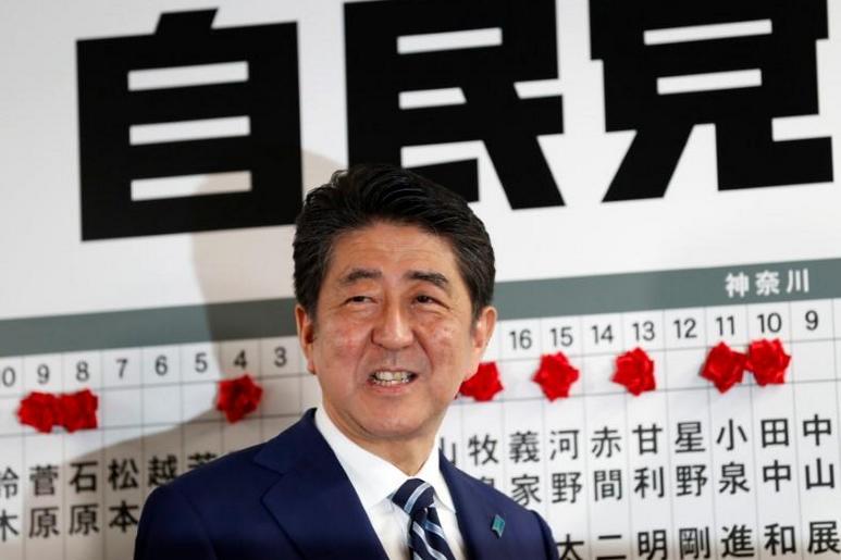 Japan's Abe says won't delay tax hike unless big shock hits economy